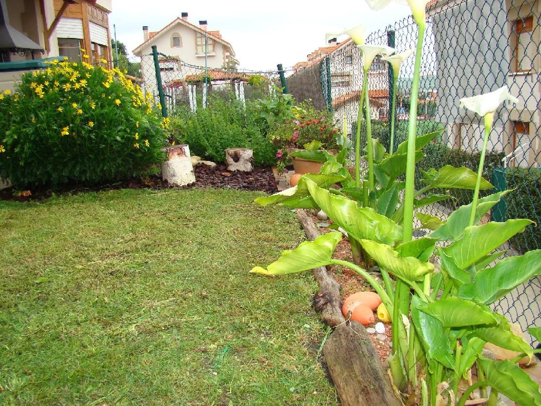 Piso bajo con jard n en urbanizaci n privada con for Bajos con jardin en pozuelo